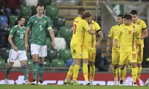 Romania's Eric Bicfalvi, center, celebrates after scoring.