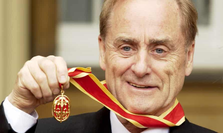 Sir Harold Evans receives his knighthood in 2004.