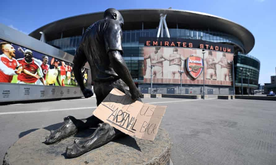 A sign saying 'Give Us Our Arsenal Back' outside Arsenal's Emirates Stadium on Tuesday