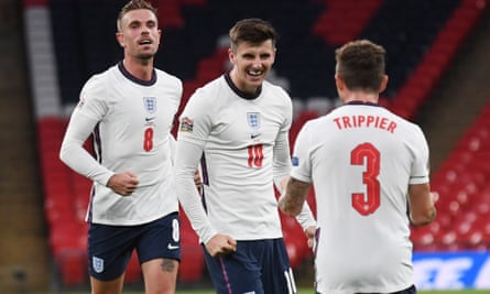 England's Mason Mount receives congratulations from his teammates after scoring against Belgium