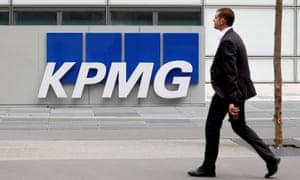 man walking past KPMG building