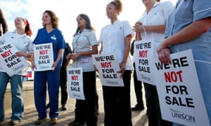 Nurses demonstrate against proposals to offer private companies more work in the NHS. 'We consider the solution to the problems TTIP poses is for the NHS to be excluded from the agreement, by way of a blanket exception,' said Michael Bowsher QC.