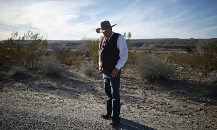 Rancher Cliven Bundy stands along the road near his ranch in Bunkerville, Nevada