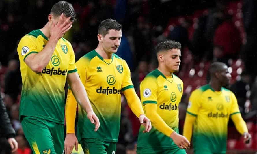 Norwich players look dejected after January's defeat at Manchester United.