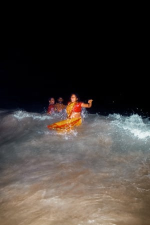 Ritual … couples plunge into the sea in Tamil Nadu.