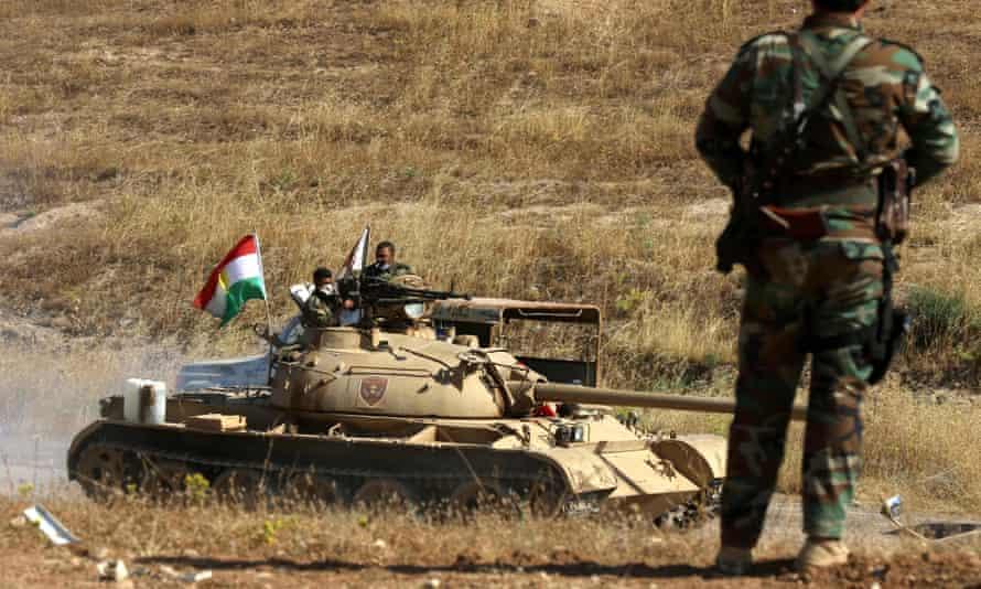 Iraqi Kurdish peshmerga fighters on the frontline east of Mosul on Sunday