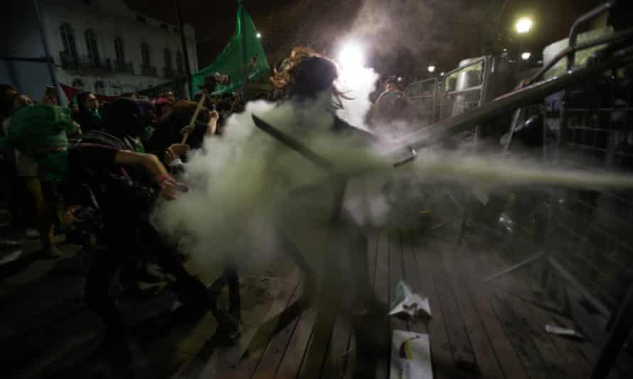 Women clash with police after lawmakers did not approve a law that decriminalizes abortion in cases of rape, outside the national assembly in Quito, Ecuador, on Tuesday.