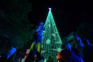 People gather to look at the tree which was attempting to beat the Guinness World Record for most lights on a tree in Canberra, Australia. The 22 metre tree had over half a million lights