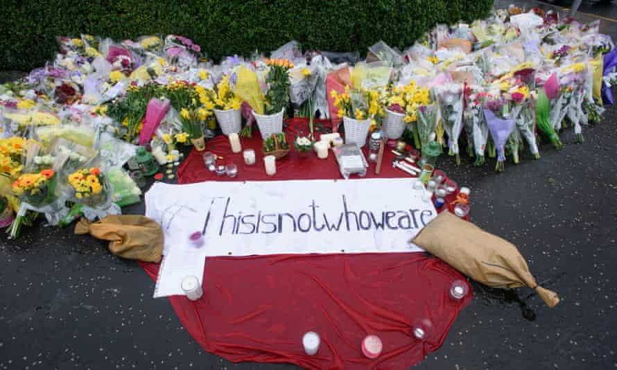 Floral tributes left outside Asad Shah's shop.
