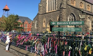 A resident puts a ribbon on the fence of St Patrick's Cathedral in Ballarat