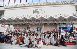 Climate and migration protesters occupy the red carpet at the 76th annual Venice international film festival in Italy
