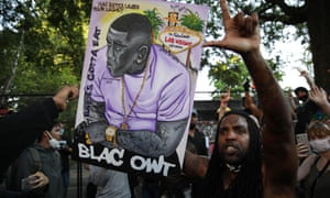 A person holds a banner during a protest over the death of George Floyd in Washington on Tuesday.