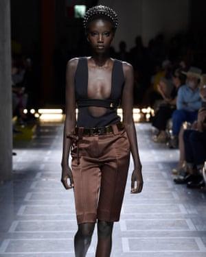 A model wears jewel-coloured duchesse satin Prada shorts.