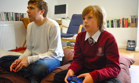 Bittersweet … the writer and his 13-year-old son, playing video games together.