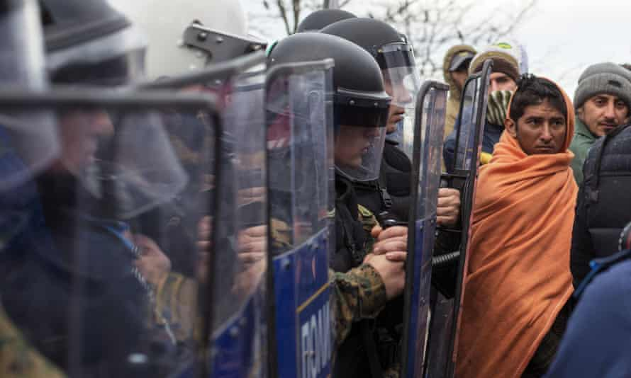 Macedonian police officers with riot shields