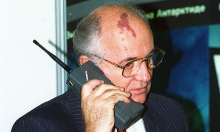 Mikhail Gorbachev speaks on a Nokia Mobira Cityman phone in Helsinki, Oct 1989.