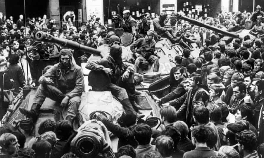 Prague residents surround Soviet tanks on 21 August 1968.