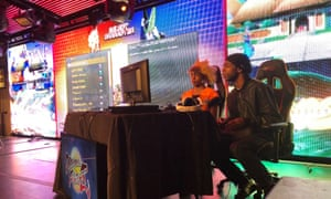 Competitors take part in a bout at the Dragon Ball FighterZ launch event