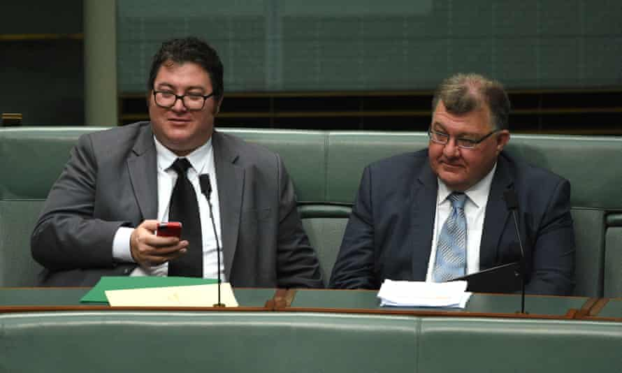 Government backbenchers George Christensen and Craig Kelly seated side by side in the House of Representatives.