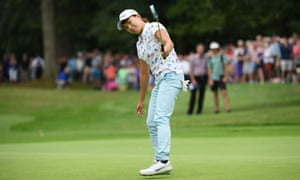 Hinako Shibuno of Japan holes the winning putt on the 18th green.