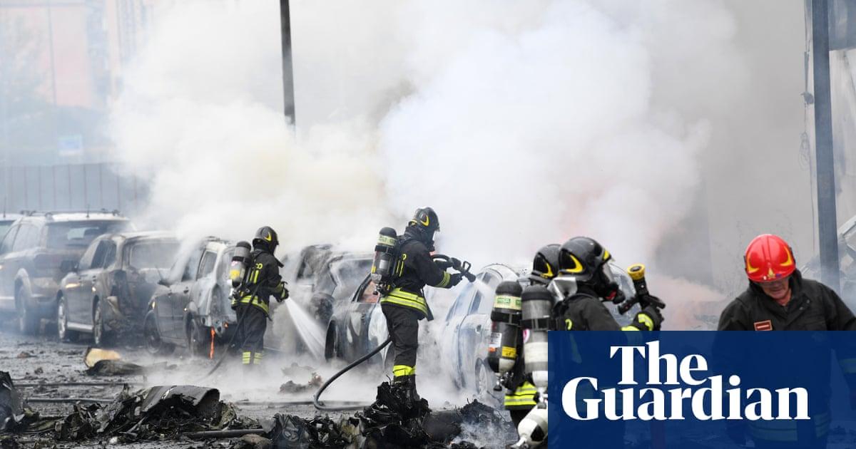 Eight killed as plane crashes into building near Milan – video