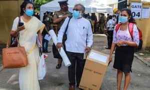 Sri Lankan polling officers carry election material to polling centres for Wednesday's vote.