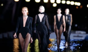 Saint Laurent's models were sent out on to a catwalk of still reflective water where they made a splash.