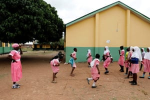 Donning the pink dress and bonnet that make up her uniform, she joins hundreds of similarly dressed pupils at a school in Ilorin, in Nigeria's western Kwara state