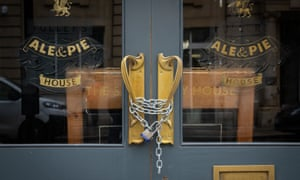 Chains on the doors of a closed Fuller's pub in London.