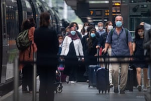 Travellers wearing face masks arriving in London from Paris on Saturday