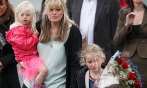 The widow of police officer David Phillips, Jennifer, and their children Abigail and Sophie.