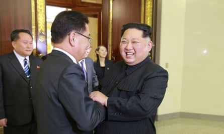 The North Korean leader, Kim Jong-un, right, welcomes members of the South Korean delegation during their meeting in Pyongyang on Monday.