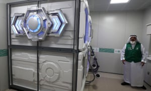Mansour al-Amer stands next to sleep pods in Mecca. The free nap pods are part of new measures Saudi Arabia is rolling out in a bid to modernise the hajj.