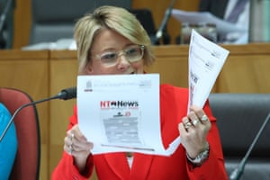 Senate Legal and Constitutional Affairs CommitteeKristina Keneally shows copies of redacted front pages of national newspapers to the commissioner of the AFP Reece Kershaw