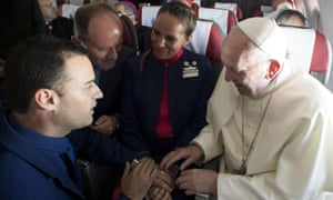 Pope Francis conducts the wedding ceremony at the front of the plane