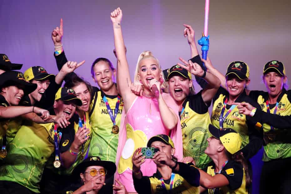 Katy Perry performs on stage with the Australian team during a concert after their victory in the ICC Women's T20 Cricket World Cup Final match between India and Australia at the Melbourne Cricket Ground in March 2020.