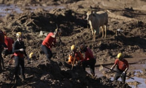 Firefighters look for victims of a dam collapse in Brumadinho, Brazil.