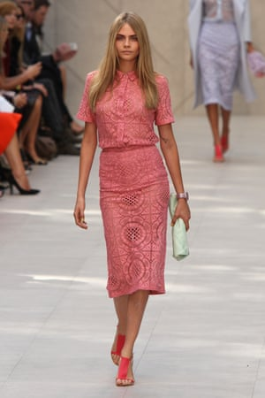 Cara Delevingne walks the runway at the Burberry Prorsum show during London fashion week in September 2013.