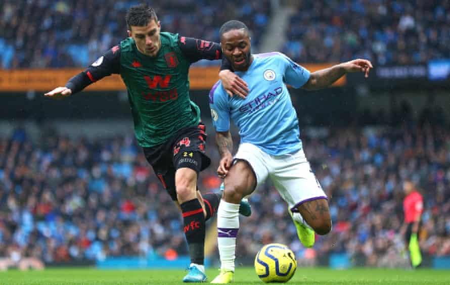 Frédéric Guilbert battles with Manchester City's Raheem Sterling