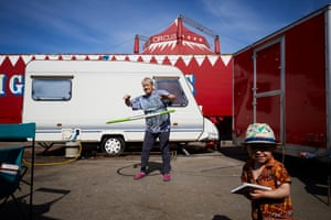 Lifelong circus performer Pam Enos hula-hoops to keep fit outside the family caravan on site