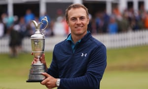 Jordan Spieth celebrates victory as he poses with the Claret Jug on the 18th green at Royal Birkdale.
