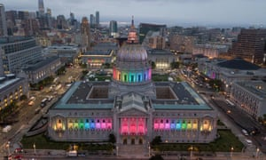 San Francisco City Hall is lit up in rainbow colors following the parade