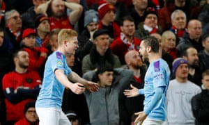 Manchester City's Kevin De Bruyne celebrates with Bernardo Silva after Manchester United's Andreas Pereira scored an own goal and the third for Manchester City.