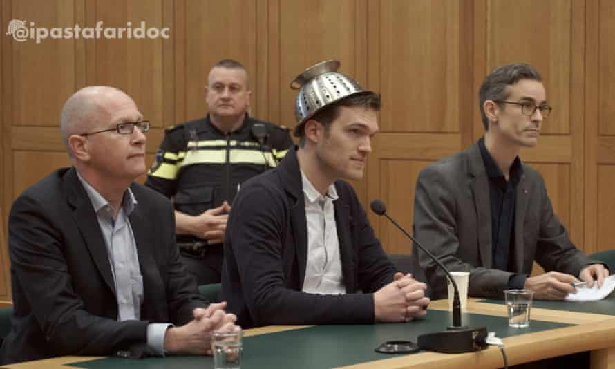 """Mathé Coolen, an """"archbishop"""" of Pastafarianism, wearing his colander in court"""