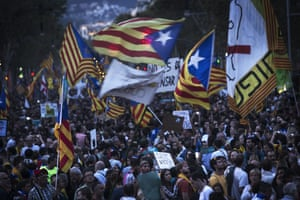 Demonstrators waving Catalan flags and signs calling for Europe to help