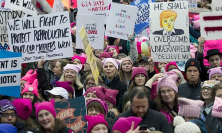 Women with pink hats protesting against Donald Trump. Knitting website Ravelry is banning users from expressing support for the US president