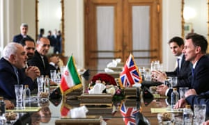 Iran's foreign minister Mohammad Javad Zarif (left) meeting with his British counterpart Jeremy Hunt (right) in Tehran