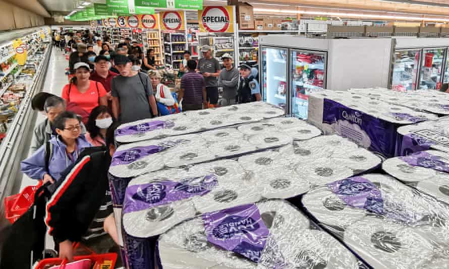 People queue to buy toilet paper, paper towels, pasta and other goods at Coles in Epping