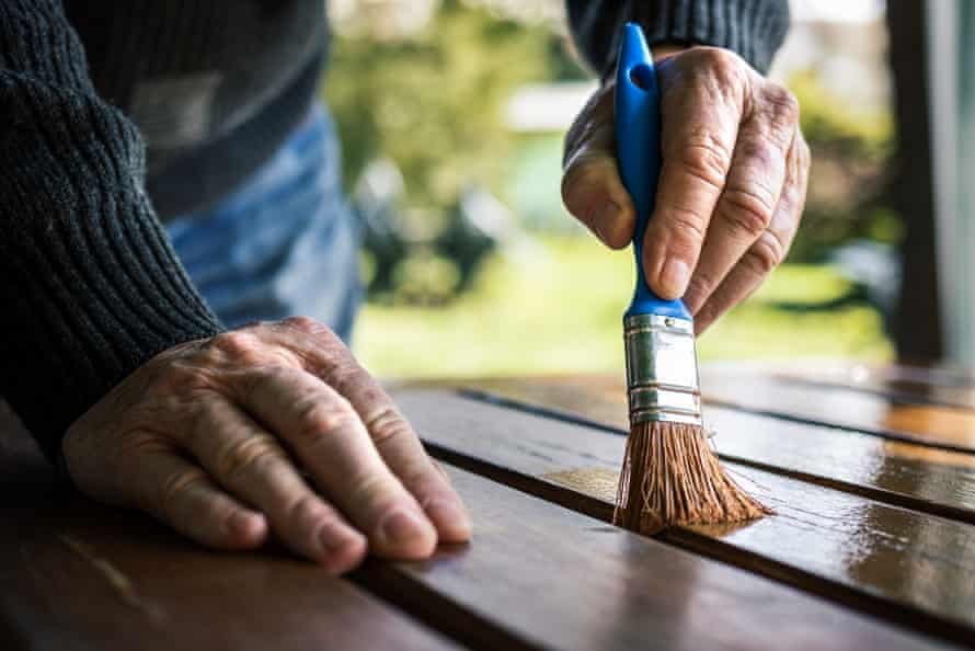 Thoroughly cleaning, then treating wooden furniture with four coats of oil once a year should be enough to keep it in good condition