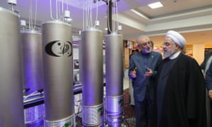 Iran's President Rouhani inspects nuclear technology in Tehran. He says the country will exceed agreed enrichment levels 'as much as is necessary'